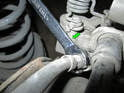 Left and Right Sides - Use a 14mm flare nut wrench (green arrow) to loosen the brake line going to the caliper.