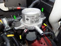 The pump is secured to the mounting bracket with two 10mm bolts (green arrows) and two 10mm nuts below (yellow arrows).