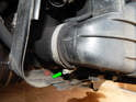 Loosen the hose clamp (green arrow) on the left side of the intercooler.