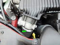 Begin by loosening the hose clamp (green arrow) holding the intercooler hose to the throttle body.