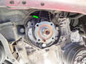 You'll be able to see the timing belt (green arrow) once the pulley is removed.