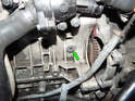 Behind the starter is the access plug (green arrow) for the crankshaft lock.