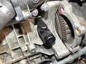 Push the crankshaft lock into the access hole until it sits flush as shown here.