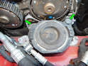 Loosen and remove the two 17mm bolts (green arrows) and maneuver the mount out of the engine bay.