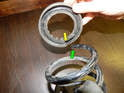When installing the springs, make sure that the top and bottom ends of the springs (green arrows) fit into the molded portion of the isolator (yellow arrow).