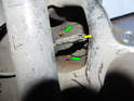Left and right sides of car: In this picture, you can see two of the four E12 Torx bolts (green arrows) that hold the bearing assembly in place.