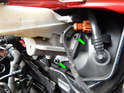 Now loosen and remove the two 13mm nuts (green arrows) holding the master cylinder to the brake booster.