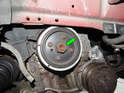 Begin by locating the 30mm nut (green arrow) holding the center of the crankshaft pulley to the crankshaft.