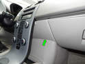 Open the glove box and pull off the panel behind the waterfall console (green arrow).