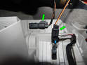 Press the tabs (green arrows) on each electrical connector to the glove box lights and pull them off.