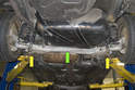 When jacking the rear of your V70, you can jack on the rear sub frame mount (yellow arrows) or on the rear suspension (green arrow).