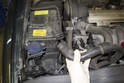 Working at the right side of the engine compartment, pull the E-box cooling vent hose off and place out of the way.
