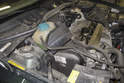 Place coolant and power steering reservoirs on engine out of your way.