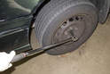 Remove the hubcap from side of vehicle you are replacing wheel bearing on.