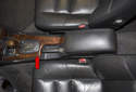 This tech article covers removing a center console on Volvo V70 models (red arrow).