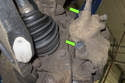 Remove rubber plugs from the brake caliper mounting fasteners (green arrows).