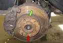 Most factory rotors and some aftermarket rotors will have a minimum thickness stamped on the rotor in one of two locations indicated by the green and red arrow.
