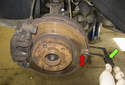 Lift the axle of the vehicle you are measuring the brake rotors on.