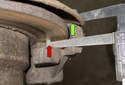 The rear rotor is a bit tougher to fit the micrometer (green arrow).