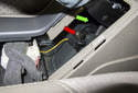 The parking brake switch (red arrow) is a single wire switch that is grounded when the parking brake is engaged.