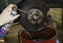 Clean all the brake dust and dirt from the parking brake system using a brake cleaner.