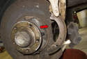 Then remove the rear parking brake shoe (red arrow).