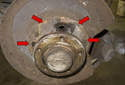 Clean the backing plate and lightly grease the brake shoe to backing plate contact points (red arrows).