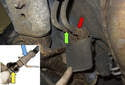 Working at the trailing arm and body junction, at the steel line and hose union, loosen the 11mm steel line nuts on the left (green arrow) and right (red arrow) side hoses.