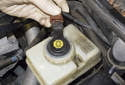 Install the brake fluid reservoir cap.