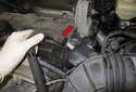 Disconnect the breather hose (red arrow) by pulling it straight off the intake air duct.