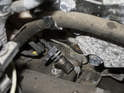 Pull the crankshaft sensor out of the transmission bell housing.