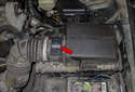 The mass air flow sensor is located in the air filter housing outlet (red arrow).