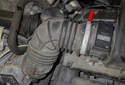 Loosen the intake air duct hose clamp (red arrow).