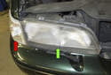 In this tech article, I will show you how to replace the headlight assembly (green arrow) and the headlight bulbs on your V70.