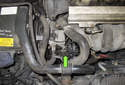 The alternator on Volvo V70 models with a normally aspirated 5-cylinder engine is located on the right side of the engine (green arrow).