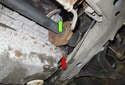 Coolant leaking down the right rear of the engine (red arrow) could be from the water pump (green arrow) or coolant pipe.