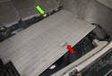 Remove the storage lid from the vehicle (red arrow) to expose the wiring harness junction (green arrow).