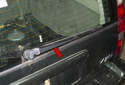 Use paint or a crayon to mark the location of the wiper arm before removing it (red arrow).