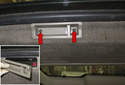Remove the tailgate interior side trim panels.