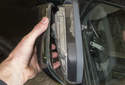 Mirror trim replacing: Use a pair of pliers to press the locking tabs (red arrows) together as you pull the cover off the mirror.