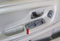 The main window switch, located in the left side door panel, can control all of the windows and cut off function of the rear windows via the rear lockout ON: OFF switch (red arrow).