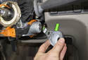 Pull the lock cylinder light (green arrow) off the lock cylinder and move it out of the way.