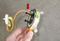 To install a new clock spring, connect the rear electrical connector.