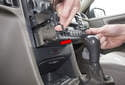 Use the small handles to pull the radio out of the instrument panel (red arrow).
