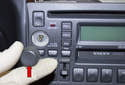 Pull the volume knob straight off the radio (red arrow).