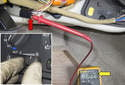 Connect the black lead of your DVOM to battery negative (ground) and the red lead to terminal 1 (red arrow).