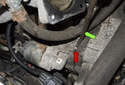 Once the fasteners are removed, the starter has to be wiggled to free the dowel pin (red arrow).