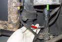 Start by disconnecting the vent solenoid electrical connector (red arrow), located next to the fuel filter (green arrow).