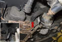 Next, remove the hose clamp (red arrow).