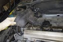 Once unclipped, lift the timing belt cover up and remove it from the engine.